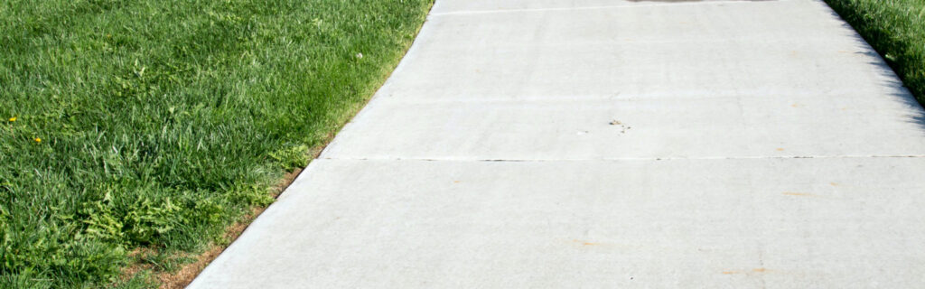 install brushed concrete driveway