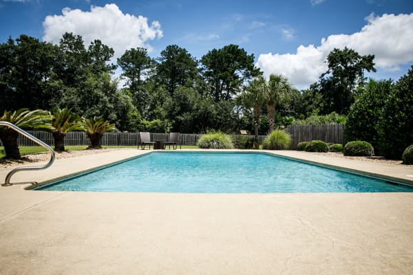 beige colored colored concrete for pool decking